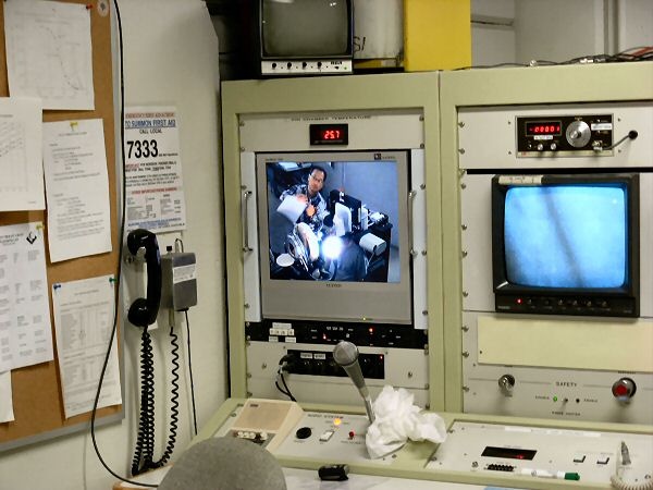 Two monitors that are watching Rob during the proton radiation treatments